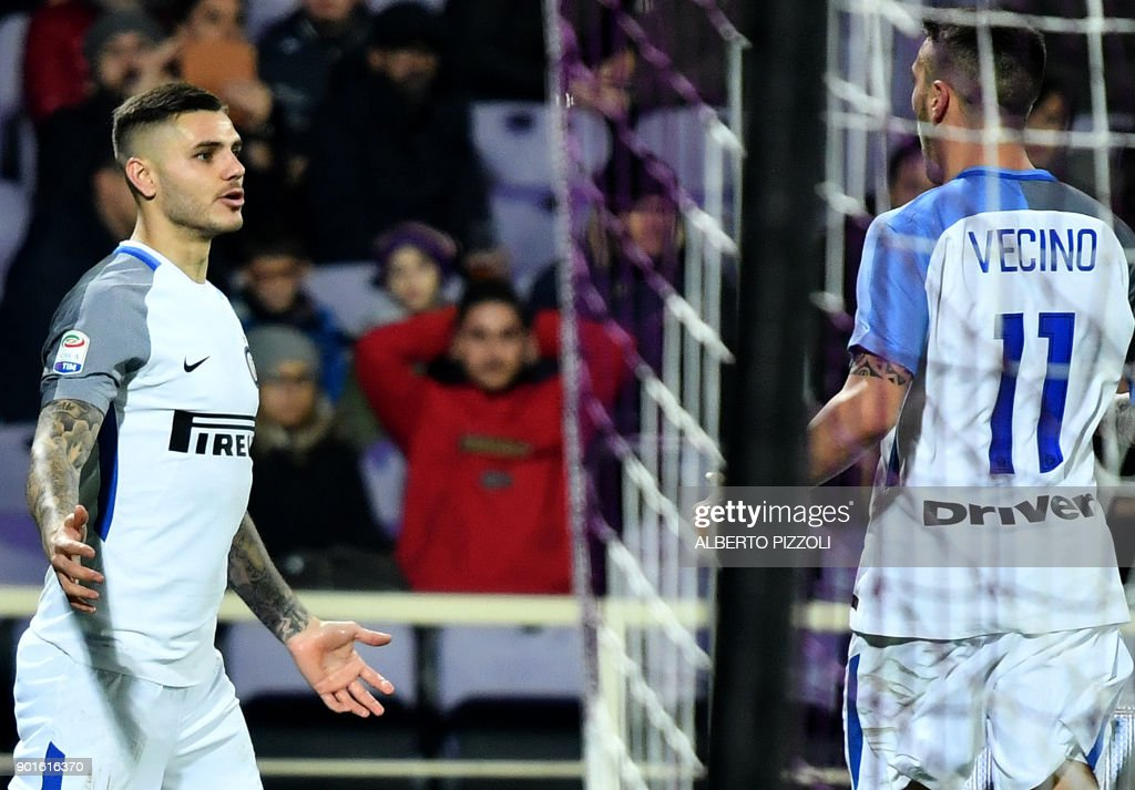 Inter Milan's Argentinian forward Mauro Icardi (L) celebrates with teammate Matías Vecino after scoring during the Italian Serie A football match between Fiorentina and Inter Milan at The Artemio Franchi Stadium in Florence on January 5, 2018. /