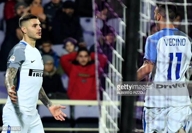 Inter Milan's Argentinian forward Mauro Icardi celebrates with teammate Matías Vecino after scoring during the Italian Serie A football match between...
