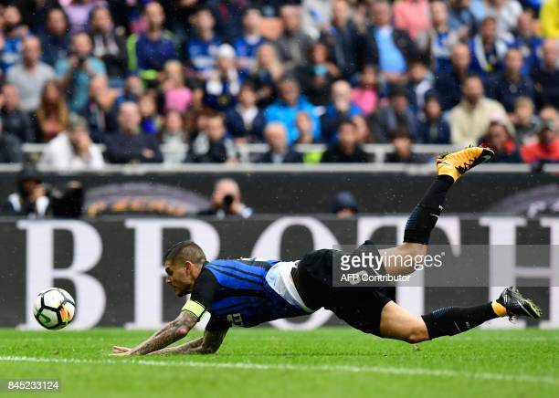 Inter Milan's Argentinian forward Mauro Icardi falls during the Italian Serie A football match between Inter Milan and Spal at San Siro Stadium in...