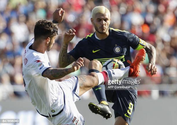 Inter Milan's Argentinian forward Mauro Icardi fights for the ball with Crotone's Italian defender Federico Ceccherini during the Italian Serie A...