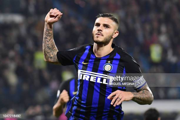 Inter Milan's Argentinian forward Mauro Icardi gestures after scoring the second goal during the Italian Serie A football match between Spal and...