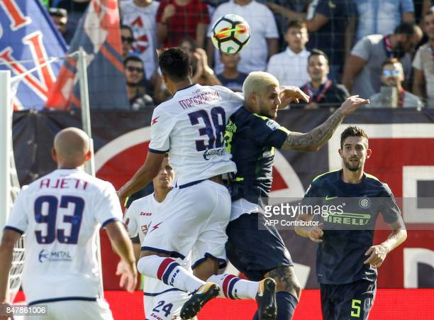 Inter Milan's Argentinian forward Mauro Icardi heads the ball as he vies with Crotone's Italian midfielder Rolando Mandragora during the Italian...