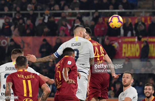 Inter Milan's Argentinian forward Mauro Icardi scores a goal during the Italian Serie A football match between AS Roma and Inter Milan at the Olympic...