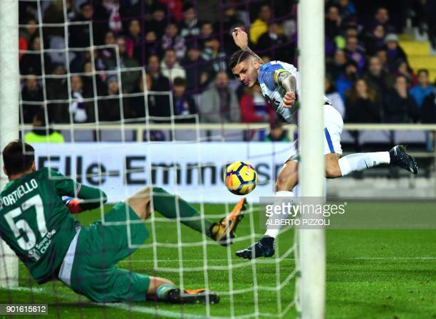 Inter Milan's Argentinian forward Mauro Icardi scores past Fiorentina's goalkeeper Marco Sportiello during the Italian Serie A football match between...