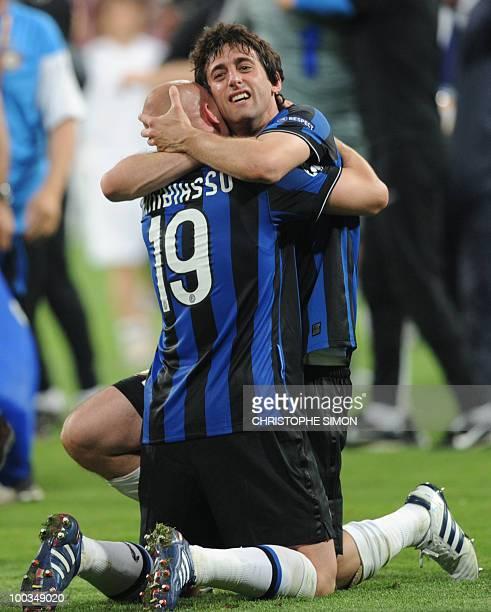 Inter Milan's Argentinian midfielder Esteban Cambiasso and Inter Milan's Argentinian forward Diego Milito celebrate after the UEFA Champions League...