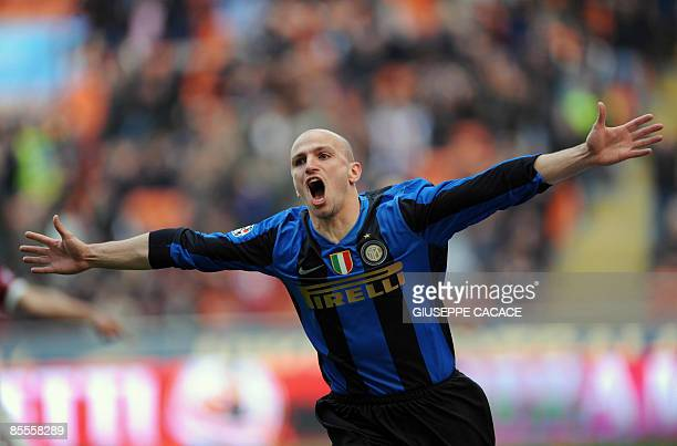 Inter Milan's Argentinian midfielder Esteban Cambiasso celebrates after scoring against Reggina during their Italian Serie A football match on March...