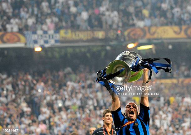 Inter Milan's Argentinian midfielder Esteban Cambiasso celebrates with the trophy after winning the UEFA Champions League final football match Inter...