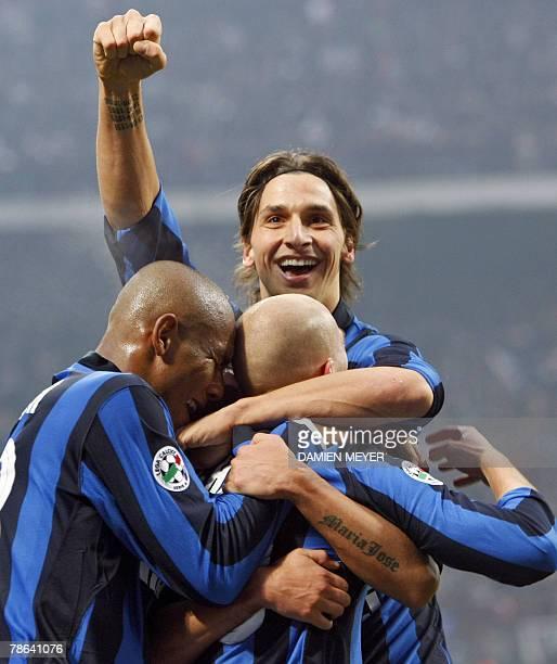 Inter Milan's Argentinian midfielder Esteban Matias Cambiasso celebrates after scoring his goal with teammates Inter Milan's Swedish forward Zlatan...