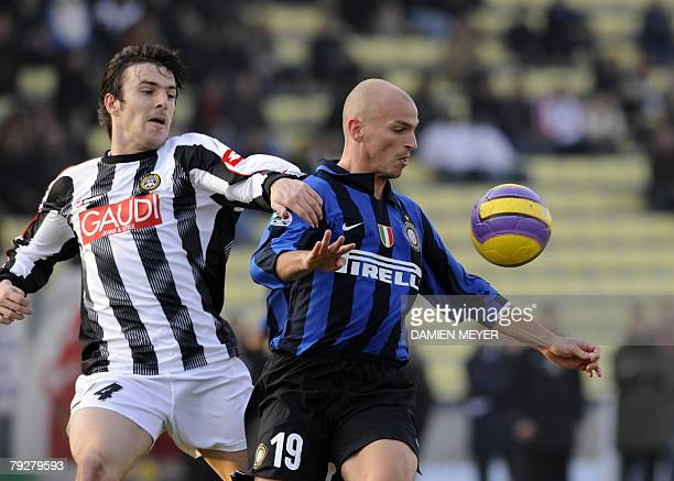 Inter Milan's Argentinian midfielder Esteban Matias Cambiasso fights for the ball with Udinese Serbian defender Aleksandar Lukovic 27 January 2008...
