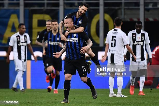 Inter Milan's Belgian defender Radja Nainggolan celebrates after scoring during the Italian Serie A football match between Inter Milan and Juventus...