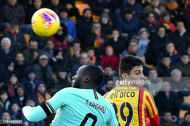 Inter Milan's Belgian forward Romelu Lukaku and Lecce's Italian defender Cristian Dell'Orco go for a header during the Italian Serie A football match...