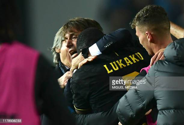 Inter Milan's Belgian forward Romelu Lukaku celebrates scoring his team's second goal with Inter Milan's Italian head coach Antonio Conte during the...