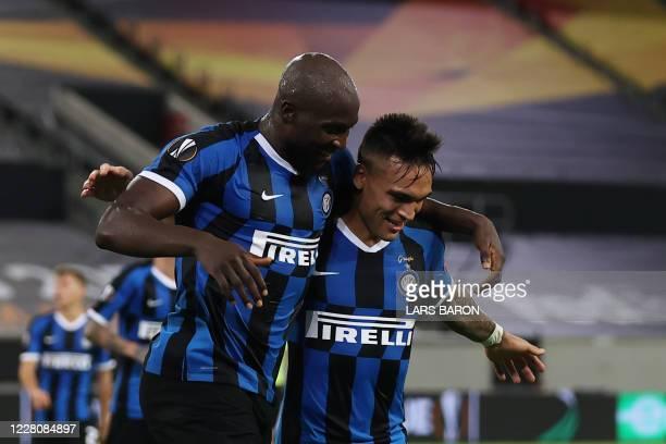 Inter Milan's Belgian forward Romelu Lukaku celebrates scoring the 4-0 goal with his team-mate Inter Milan's Argentinian forward Lautaro Martinez...