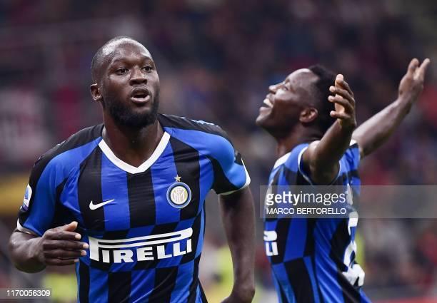 Inter Milan's Belgian forward Romelu Lukaku celebrates with Inter Milan's Ghanaian defender Kwadwo Asamoah after scoring during the Italian Serie A...