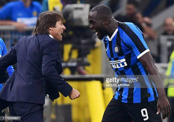 Inter Milan's Belgian forward Romelu Lukaku celebrates with Inter Milan's Italian head coach Antonio Conte after scoring during the Italian Serie A...