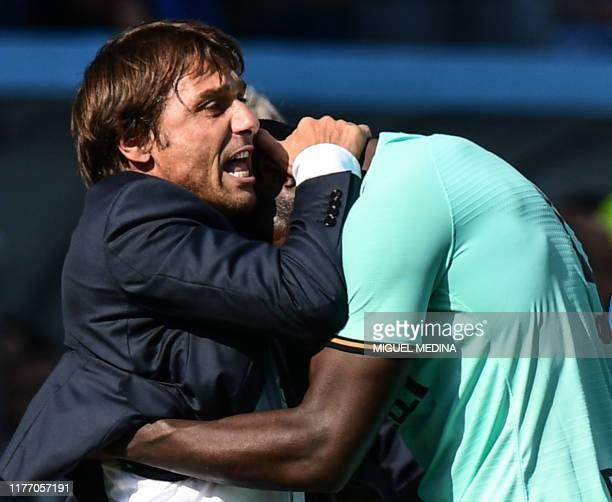 Inter Milan's Belgian forward Romelu Lukaku celebrates with Inter Milan's Italian head coach Antonio Conte after scoring his first goal during the...