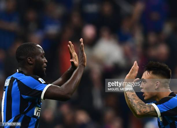 Inter Milan's Belgian forward Romelu Lukaku celebrates with Inter Milan's Argentinian forward Lautaro Martinez after scoring an equalizer during the...