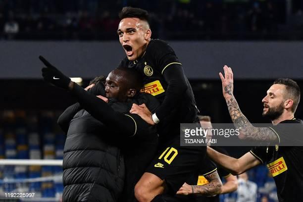 Inter Milan's Belgian forward Romelu Lukaku celebrates with Inter Milan's Argentinian forward Lautaro Martinez and Inter Milan's Croatian defender...