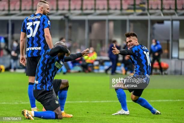 Inter Milan's Belgian forward Romelu Lukaku celebrates with Inter Milan's Argentine forward Lautaro Martinez after scoring a penalty during the...