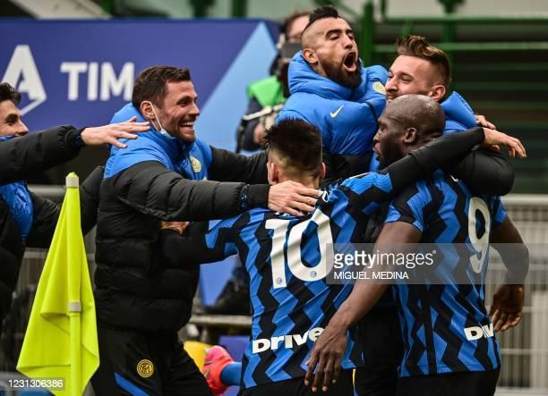 Inter Milan's Belgian forward Romelu Lukaku celebrates with Inter Milan's Argentine forward Lautaro Martinez , Inter Milan's Romanian goalkeeper...