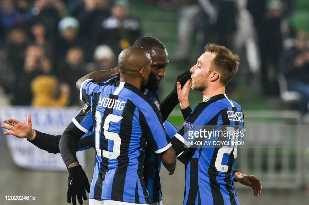 Inter Milan's Belgian forward Romelu Lukaku celebrates with teammates Inter Milan's English midfielder Ashley Young and Inter Milan's Christian...