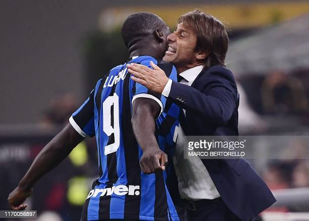 TOPSHOT Inter Milan's Belgian forward Romelu Lukaku embraces Inter Milan's Italian head coach Antonio Conte after scoring during the Italian Serie A...