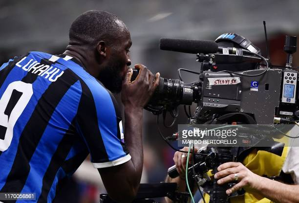 TOPSHOT Inter Milan's Belgian forward Romelu Lukaku goes to kiss the lens of a live television steadycam after scoring during the Italian Serie A...