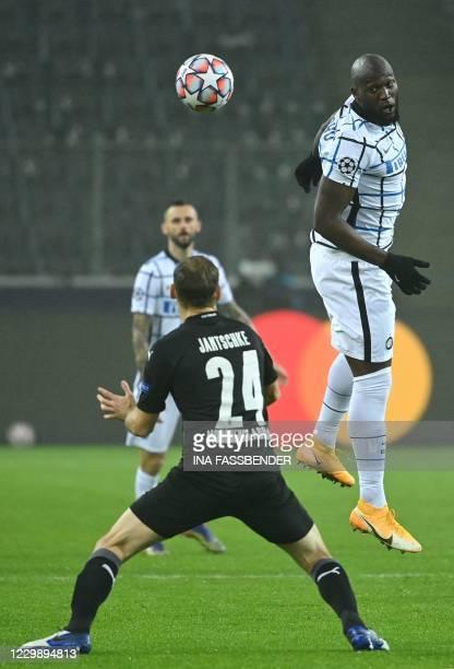 Inter Milan's Belgian forward Romelu Lukaku heads the ball past Moenchengladbach's German defender Tony Jantschke during the UEFA Champions League...