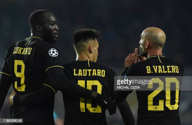 Inter Milan's Belgian forward Romelu Lukaku Inter Milan's Argentinian forward Lautaro Martinez and Inter Milan's Spanish midfielder Borja Valero...