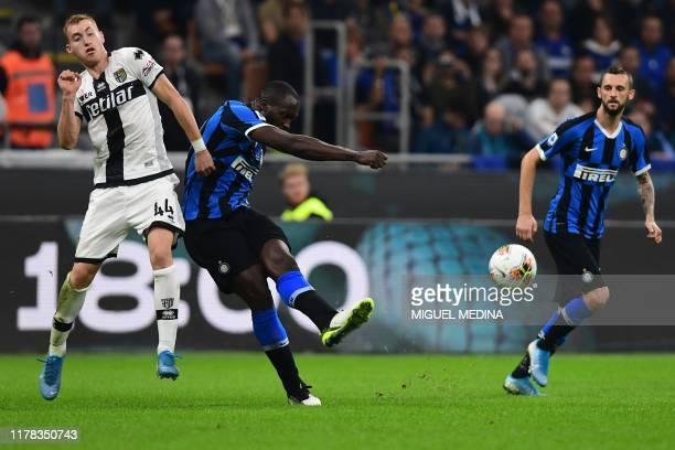 Inter Milan's Belgian forward Romelu Lukaku kicks the ball despite Parma's Swedish midfielder Dejan Kulusevski during the Italian Serie A football...