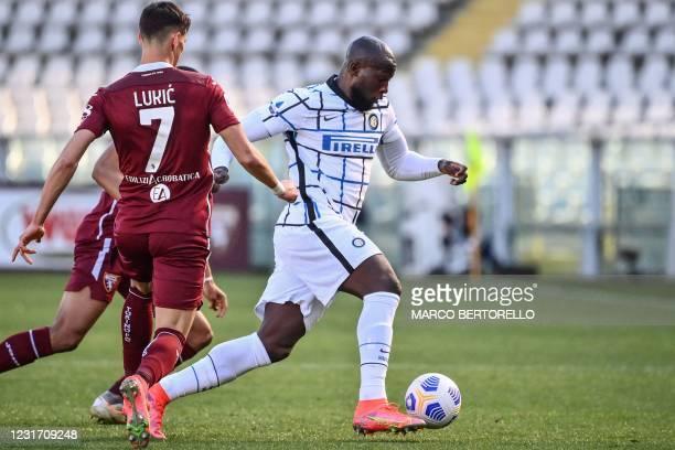 Inter Milan's Belgian forward Romelu Lukaku outflanks Torino's Serbian midfielder Sasa Lukic during the Italian Serie A football match Torino vs...