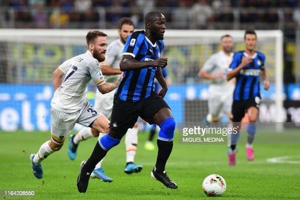 Inter Milan's Belgian forward Romelu Lukaku outruns Lecce's Slovenian midfielder Zan Majer during the Italian Serie A football match Inter Milan vs...