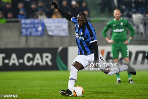 Inter Milan's Belgian forward Romelu Lukaku scores from the penaltykick during the UEFA Europa League round of 32 first leg football match between...