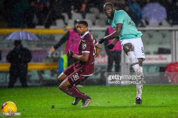 Inter Milan's Belgian forward Romelu Lukaku shoots on goal despite Torino's Brazilian defender Bremer during the Italian Serie A football match...