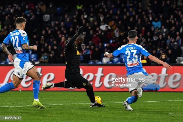 Inter Milan's Belgian forward Romelu Lukaku shoots to open the scoring despite Napoli's Italian defender Giovanni Di Lorenzo and Napoli's Albanian...