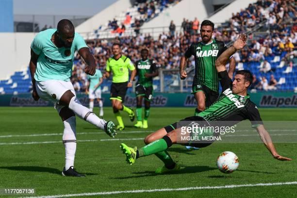 Inter Milan's Belgian forward Romelu Lukaku shoots to score his first goal during the Italian Serie A football match Sassuolo vs Inter Milan on...