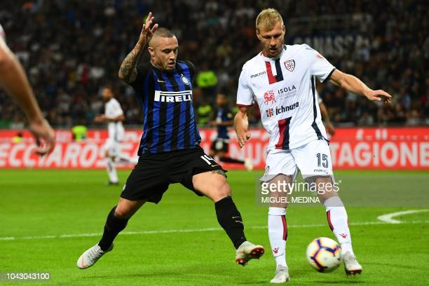 Inter Milan's Belgian midfielder Radja Nainggolan and Cagliari's Estonian defender Ragnar Klavan go for the ball during the Italian Serie A football...