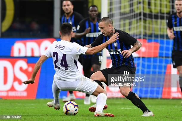 Inter Milan's Belgian midfielder Radja Nainggolan fights for the ball with Fiorentina's Italian midfielder Marco Benassi during the Italian Serie A...