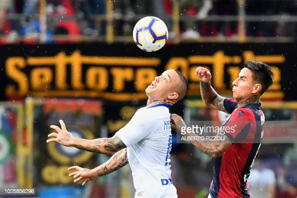 Inter Milan's Belgian midfielder Radja Nainggolan heads the ball as he fights for it with Bologna's Chilean midfielder Erick Pulgar during the...