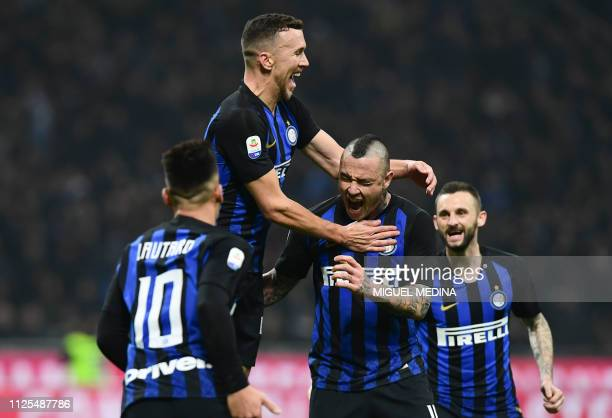 Inter Milan's Belgian midfielder Radja Nainggolan is congratulated by Inter Milan's Argentine forward Lautaro Martinez Inter Milan's Croatian...