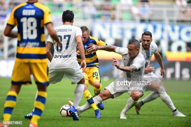 Inter Milan's Belgian midfielder Radja Nainggolan tackles the ball against Parma's Italian forward Antonio Di Gaudio during the Italian Serie A...