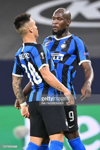 Inter Milan's BelgIna forward Romelu Lukaku celebrates scoring the opening goal with his teammate Inter Milan's ArgentinIna forward Lautaro Martinez...