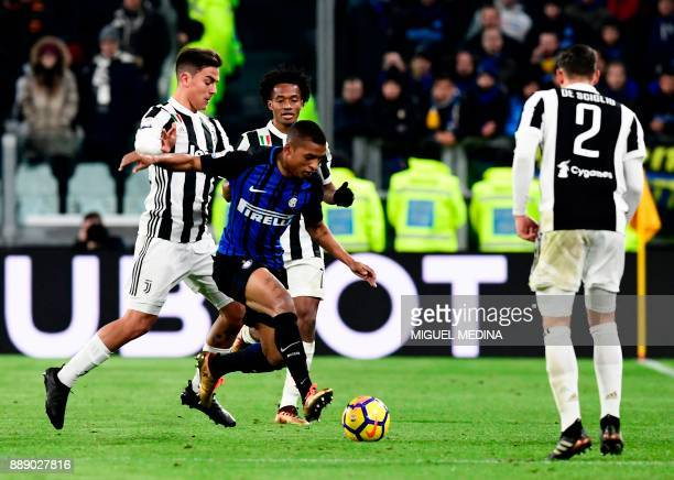 Inter Milan's Brazilian defender Henrique Dalbert vies with Juventus players during the Italian Serie A football match between Juventus and Inter...