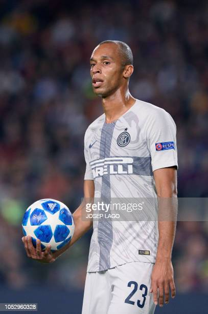 Inter Milan's Brazilian defender Joao Miranda grabs the ball during the UEFA Champions League group B match Barcelona against Inter Milan at the Camp...