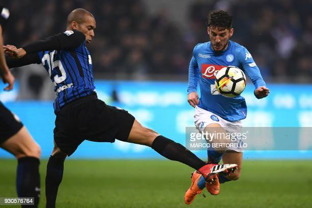 Inter Milan's Brazilian defender Joao Miranda tackles Napoli's Belgian forward Dries Mertens during the Italian Serie A football match Inter Milan vs...