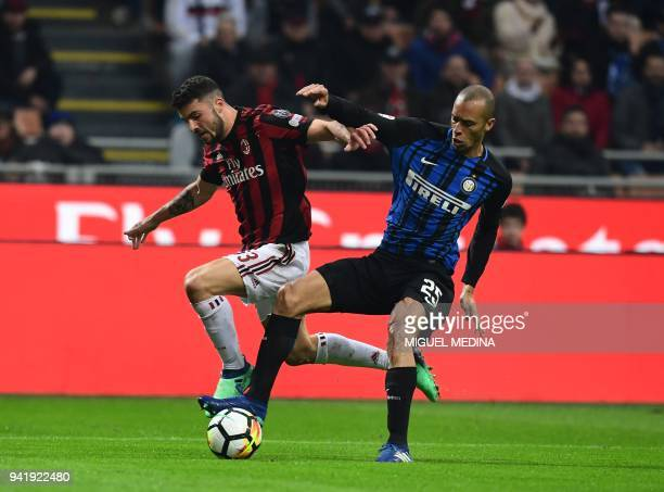 Inter Milan's Brazilian defender Joao Miranda vies with AC Milan's Italian forward Patrick Cutrone during the Italian Serie A football match AC Milan...