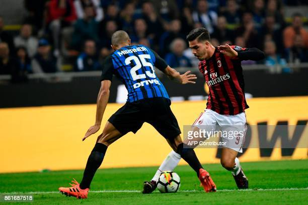 Inter Milan's Brazilian defender João Miranda vies with AC Milan's Portuguese forward Andre Silva during the Italian Serie A football match Inter...
