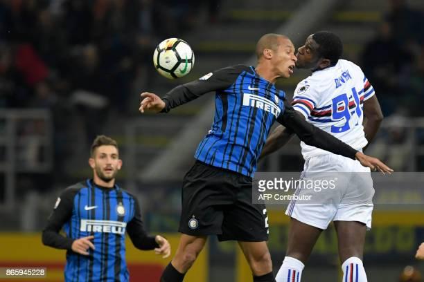 Inter Milan's Brazilian defender João Miranda vies with Sampdoria's Colombian forward Duvan Zapata during the Italian Serie A football match Inter...