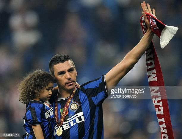 Inter Milan's Brazilian defender Lucio Da Silva Ferreira Lucimar holds a Bayern Munich scarf after the UEFA Champions League final football match...