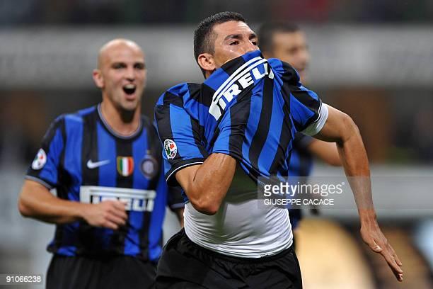 Inter Milan's Brazilian defender Lucio Da Silva Ferreira Lucimar celebrates after scoring during their Serie A football match Inter Milan vs Napoli...